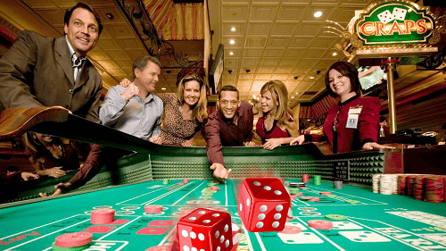 People Rolling dice at craps Table