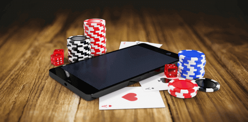 Photo of Dice & Chips on top of Smartphone